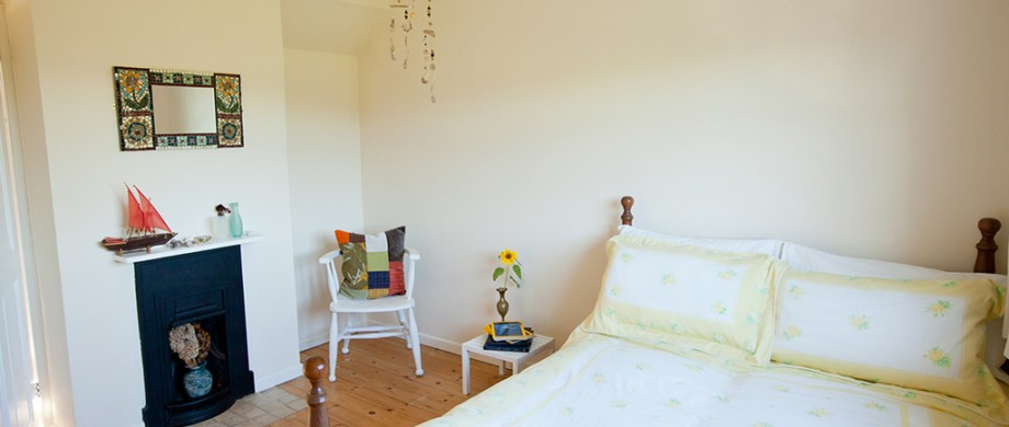 country coastal bedroom at The Pink House Lulworth Dorset self catering accomodation