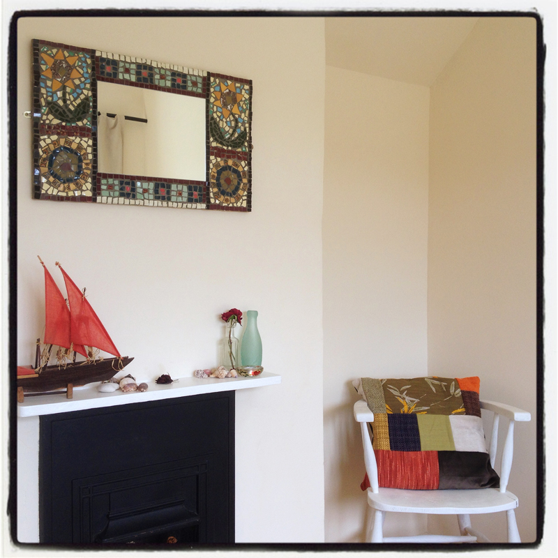 hand-made-mosaic-mirrors-and-patchwork-cushions-decorate-The-Pink-House-Lulworth-Dorset
