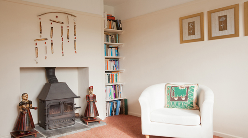 wood burning stove in both lounges at The Pink House Lulworth Dorset self catering accomodation