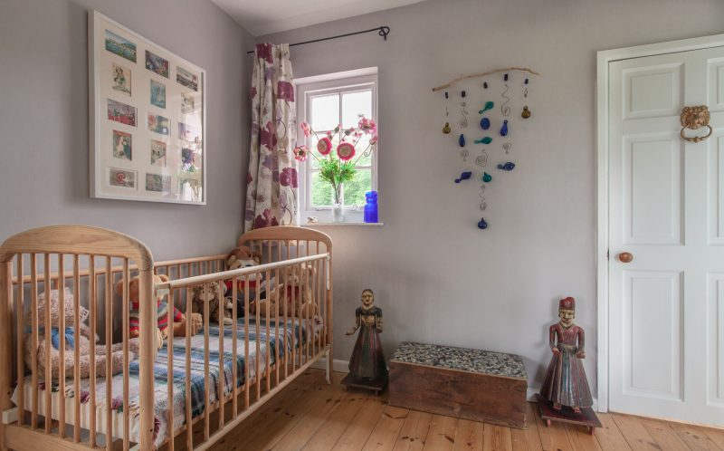 wooden cot for little people staying at The Pink House Lulworth Dorset holiday cottage
