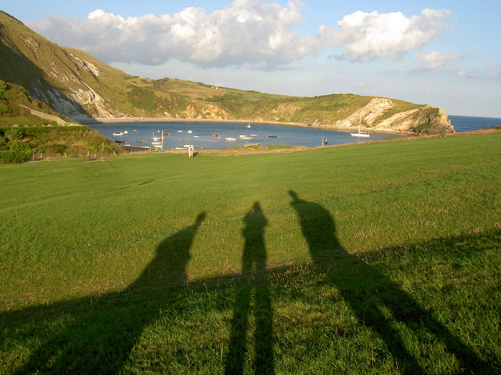 the village green at Lulworth Cove is a lovely place to take in the view of its famous horse shoe shaped beach