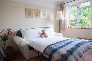 double sofa bedroom sleeps an extra 2 guests at The Pink House Lulworth